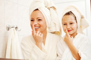 mom daughter washing face